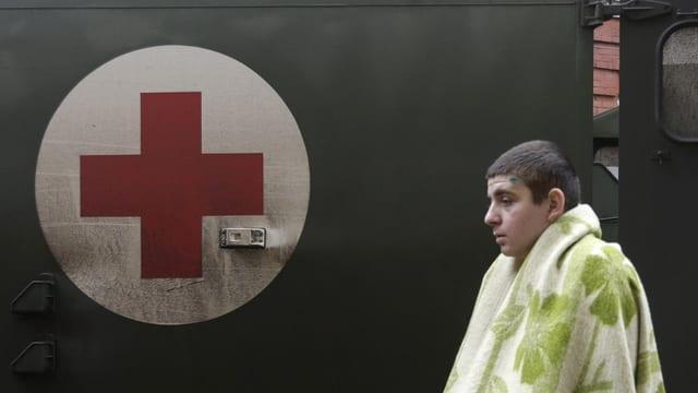 schuldà blessà avant ambulanza