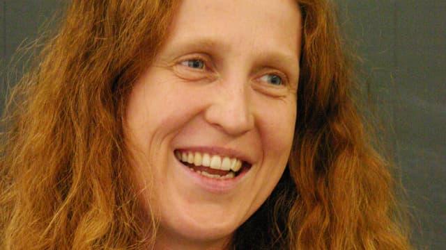 Bild von Susanne Birke, Frau mit roten Haaren und blauen Augen