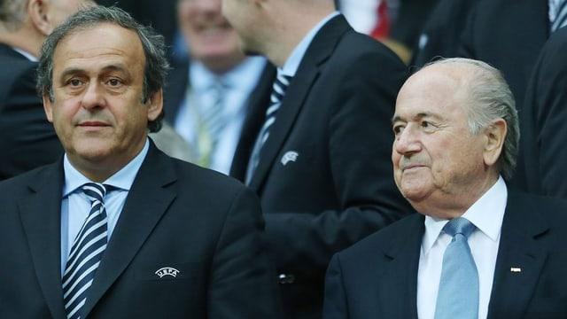 Michel Platini (san.) e Sepp Blatter (dre.), foto d'archiv avant il gieu final da l'UEFA EURO 2012.
