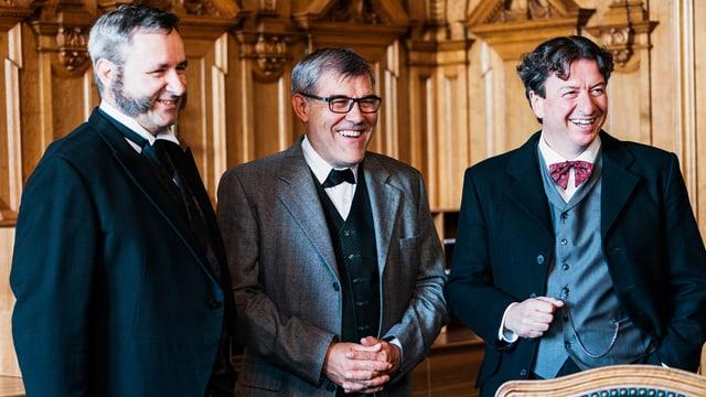 Werner Salzmann, Eric Nussbaumer und Corrado Pardini in Parlamentssaal.
