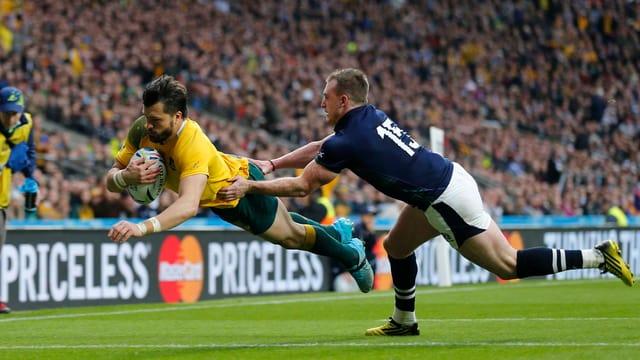 Australia encunter Scozia al campiunadi mundial da rugby en l'Engalterra.