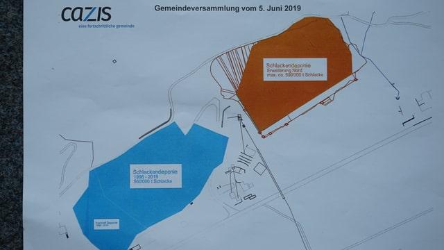 La deponia existenta è colurada blau, en la zona cotschna pudessi dar ina nova deponia.