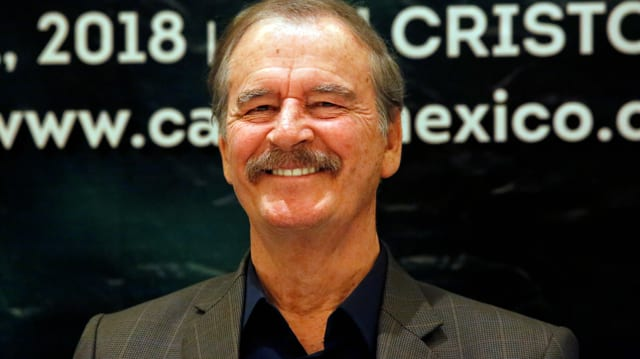 Vicente Fox, er lacht.