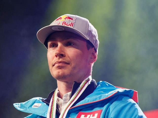 PUrtret Erik Guay cun medaglia.