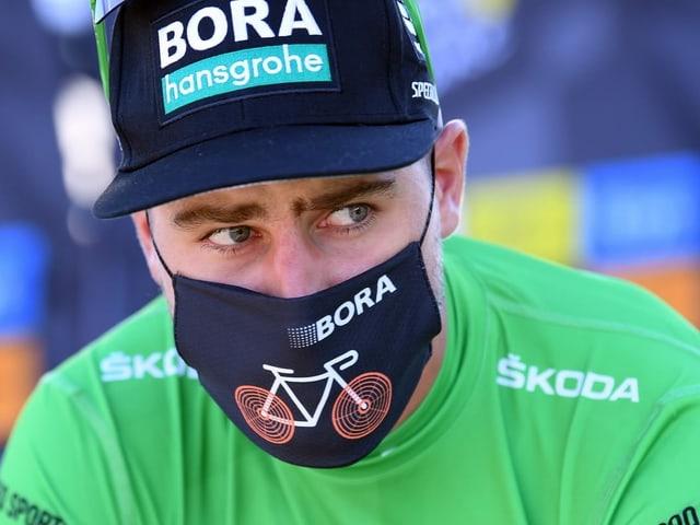 Peter Sagan in Grün gekleidet.
