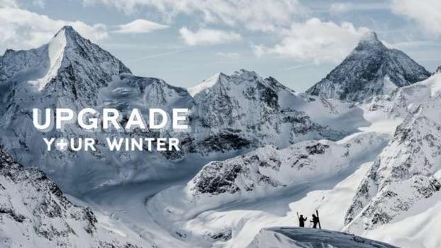 Purtret da muntogna cun scrit davantvart «Upgrade your winter».