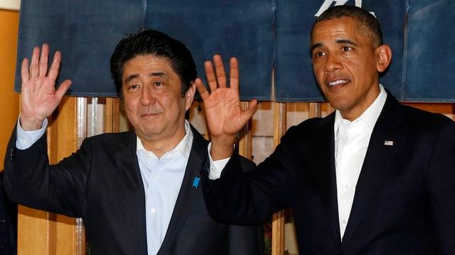 Der japanische Ministerpräsident Shinzo Abe und US-Präsident Barack Obama winken