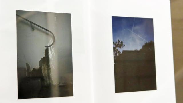 Ein weisses Buch mit zwei Fotos darin.