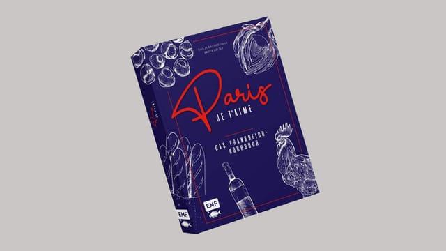 Blaues Buch mit roter Schrift: «Paris je t'aime».