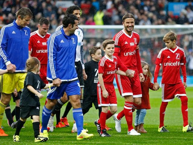 David Beckham mit seinen Kindern Cruz, Romeo and Harper