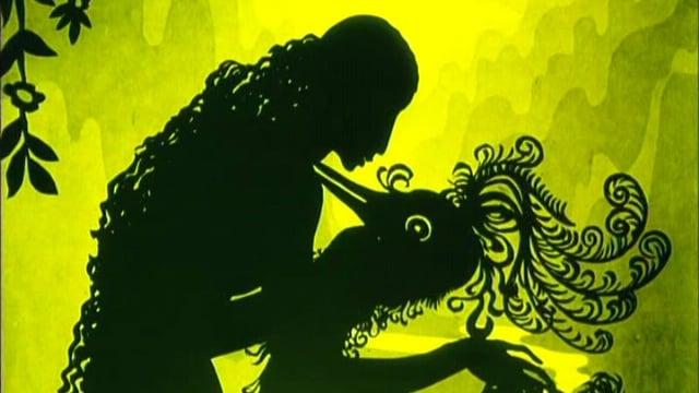 Eine Frau tanzt mit einem Pfau: Schattenriss aus einem Film von Lotte Reiniger.