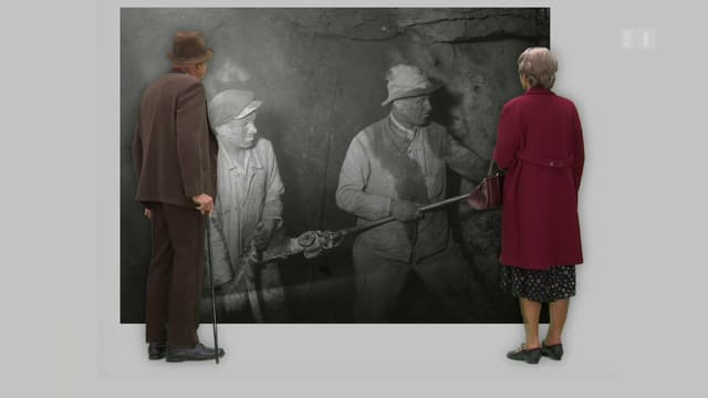 Schwarzweiss-Aufnahme von Bergarbeitern.