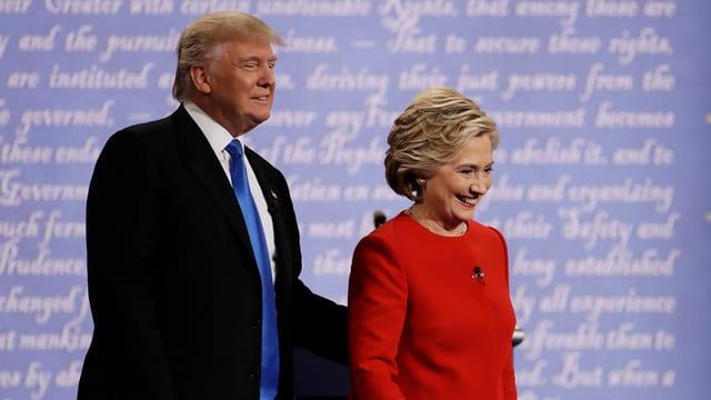 Trump e Clinton in dasper l'auter avant la debatta.