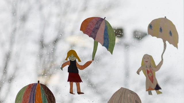 Papierfiguren mit Schirm vor verregneter Fensterscheibe.