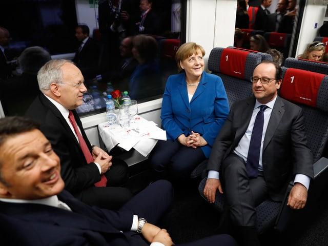 Renzi, Schneider-Ammann, Merkel, Hollande im Zug.