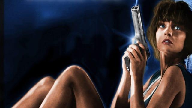 Die Titelheldin Nikita sitzt mit rauchender Pistole am Boden.
