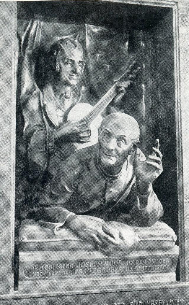 Sculptura commemorativa da Josep Mohr e Franz Gruber a Oberndorf, Austria