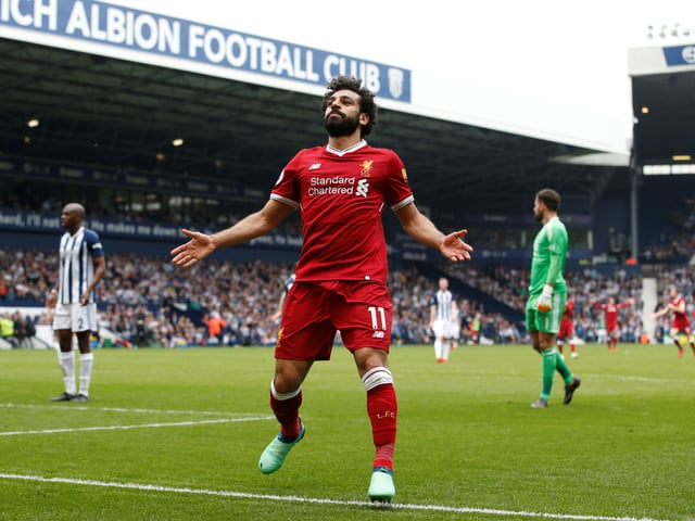Mohamed Salah jubelt auf dem Rasen.