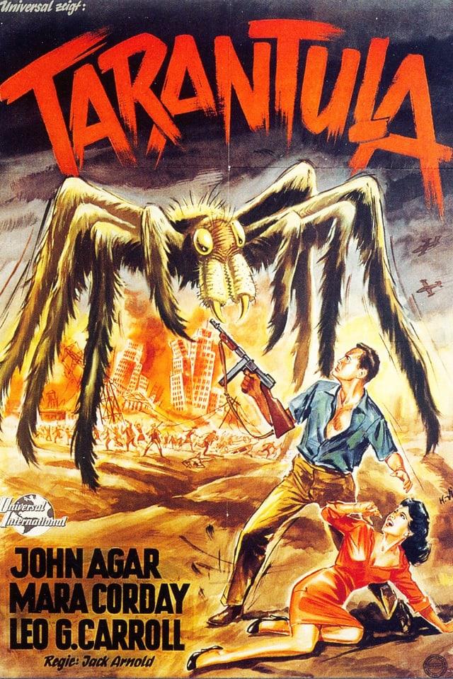 Filmposter: Eine Riesenspinne bedroht einen Mann mit Maschinengewehr und eine Frau, die schreiend auf dem Boden liegt.