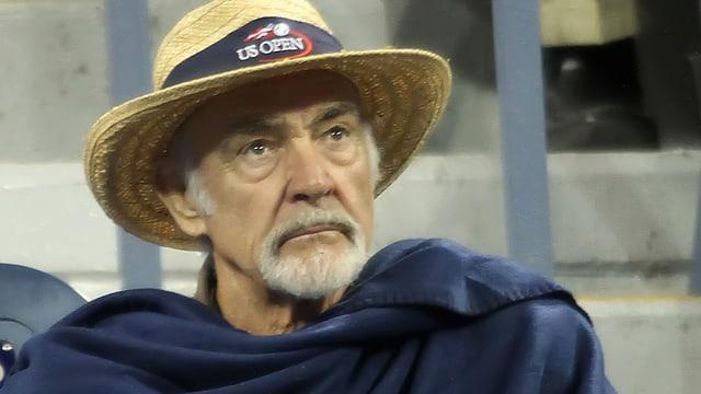 Sean Connery mit nachdenklichem Blick und einem Strohhut.