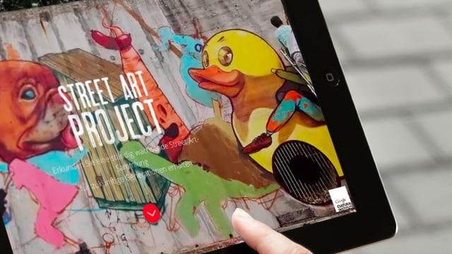 Man sieht Graffiti auf einem Ipad. Die Startseite des «Street Art Projects».