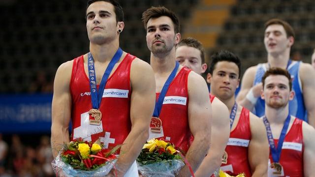 La squadra cun las medaglias