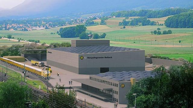 Bildmontage der fertigen Anlage. Sie steht gleich neben der Bahnlinie Solothurn-Grenchen, auf der Seite des Juras. Es ist ein grauer, grosser Bau, der aus mehreren Gebäudeteilen besteht.