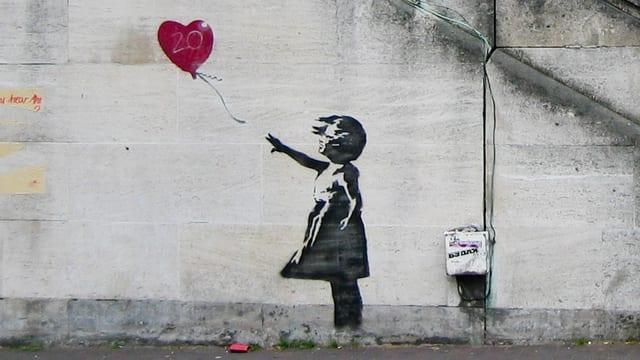 Eines der berühmtesten Bilder von Banksy prangt an einer Wand in London.