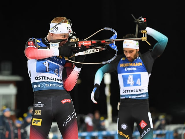 Johannes Thingnes Bö (l.) und Martin Fourcade.