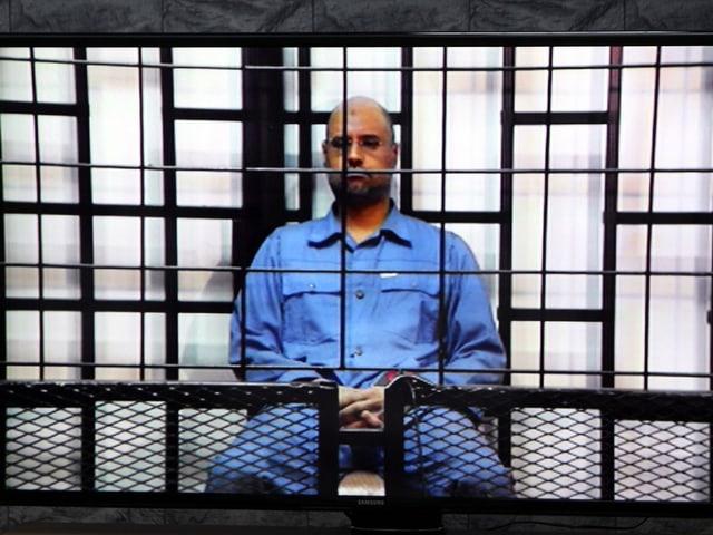 Saif al-Islam hinter einem Gitter / Videoscreenshot