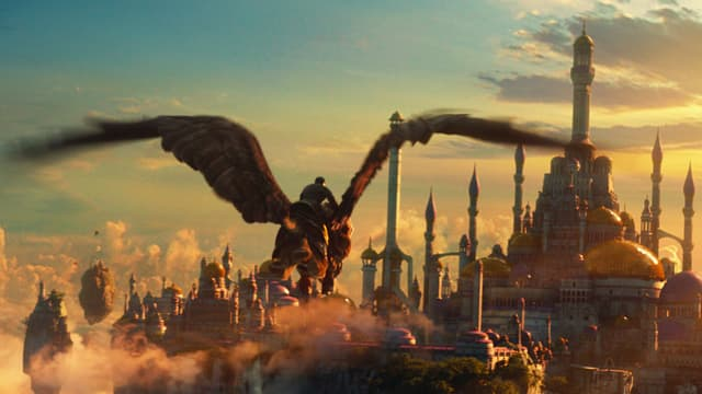 Man fliegt auf Riesenadler im Abendlicht.