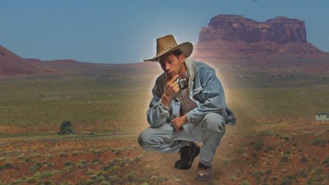Albumcover von «Physical Therapy»: Ein Cowboy in Jeans-Kleidung wurde schlecht in eine Westernlandschaft hineinmontiert.
