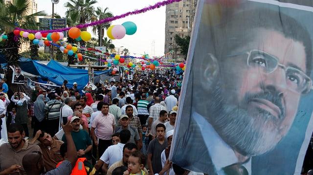 Mursi-Anhänger demonstrieren in Kairo für dessen politische Rückkehr.
