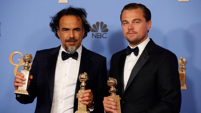 Il reschissur Alejandro Inarritu (sanester) e l'actur Leonardo DiCaprio.