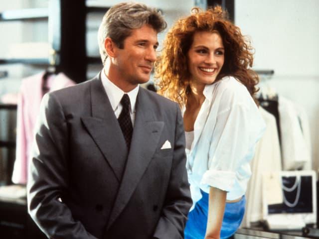 Richard Gere und Julia Roberts lachend im Film Pretty Woman.