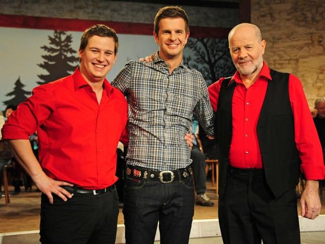 Pascal Suter, Nicolas Senn und Gody Schmid lächeln in Kamera