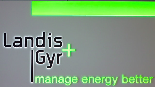Purtret dal logo da «Landis und Gyr».