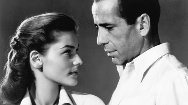 Lauren Bacall als Nora Temple, Humphrey Bogart als Frank McCloud.