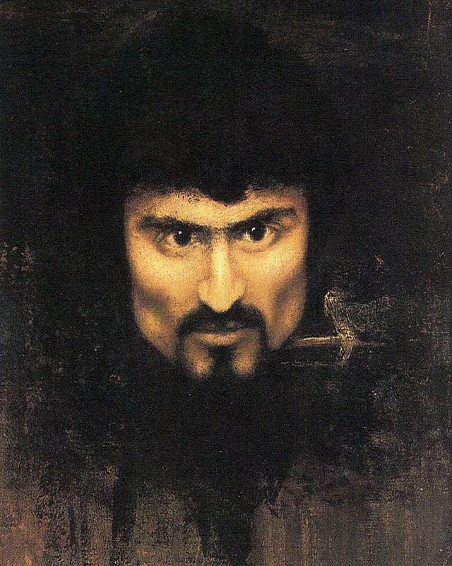 Selbstporträt mit stechenden, dunklen Augen.