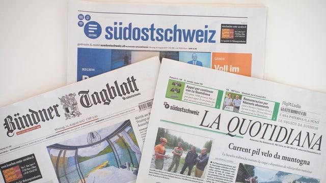 Gasettas da la Südostschweiz, il Bündner Tagblatt e la Quotidiana.