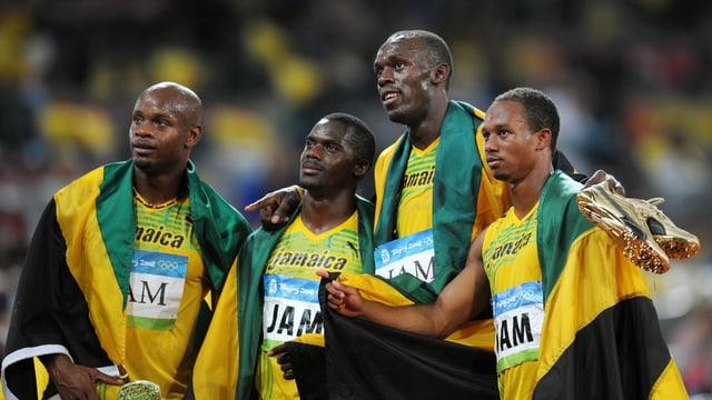 Die jamaikanischen Sprinter posieren für ein Foto.