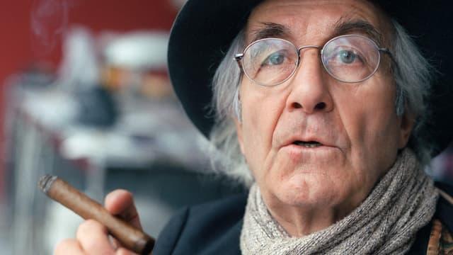 Porträt des Fotografen René Burri mit Zigarre.