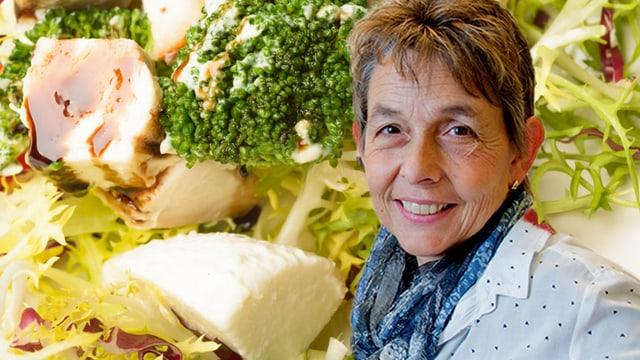 Porträt Beatrice Conrad vor Gemüsehintergrund.