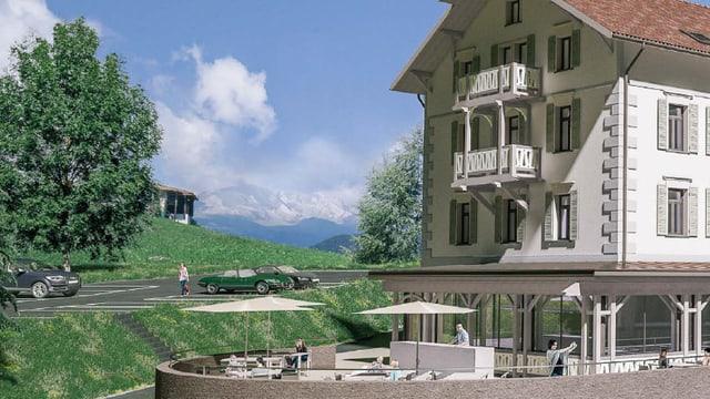 Visualisaziun dal hotel renovà cun terrassa e parasols.