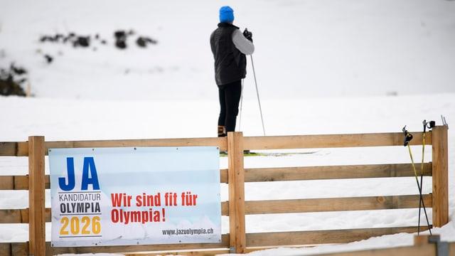 Purtret d'in placat «Ja olympia 2026»