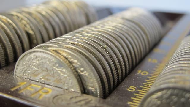 Eine Geldkassette mit Einfränklern.