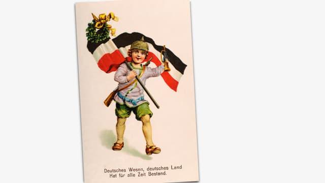 Postkarte mit Kind, das ein Gewehr umgehängt hat und die deutsche Reichsflagge trägt.