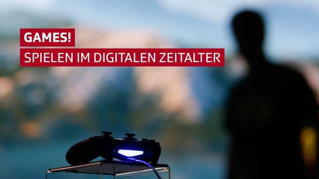 Ein Game-Controller, dahinter unscharf die Silhouette einer Person.