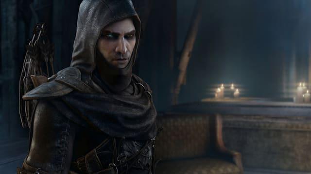 Der Protagonist Garrett in dunkler Kapuze und mit je einem blauen und einem braunen Auge.