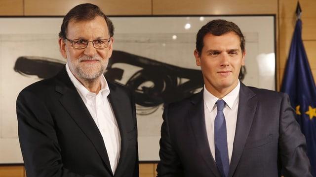 Mariano Rajoy e Albert Rivera suenter la sesida da vart las cundiziuns per ina collavuraziun.